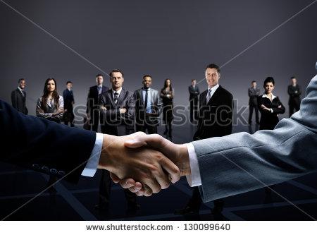 stock-photo-handshake-isolated-on-business-background-130099640